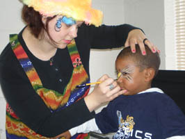 an oddzin ends face painter is painting away