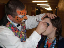 an oddzin ends face painter who looks like a tiger