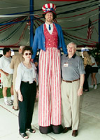 Chuck Flayhart stilt walking as Uncle Sam